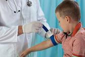 Little boy before taking blood sample — Stock Photo