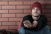 Young homeless man begging  — Stock Photo