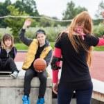 Girl waving goodbye at skatepark — Stock Photo #52500281