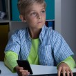 Young boy with phone and computer — Stock Photo #52501599