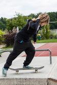 Teenage girl riding her skateboard — Stock Photo