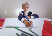 Boy writing something in notebook — Stock Photo