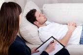 Therapist working with patient on hypnosis — Stock Photo