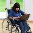 Disabled woman using laptop — Stock Photo #52646203