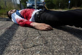 Dead man lying on the street — Stock Photo