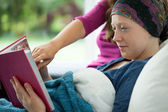 Girl with cancer holding photo album — Stockfoto