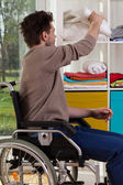 Disabled man reaching out for blanket — Stock Photo