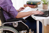 Disabled man studying at home — Stock Photo