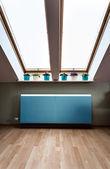 Modern radiator in the attic — Stock Photo
