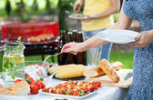 Friends during garden party — Stock Photo