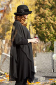 Widow at the cemetery — Stock Photo