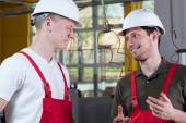 Colleagues from factory discussing during work — Stock Photo
