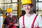 Laborers in overalls and hardhat — Stock Photo