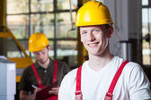 Men during work at factory — Stock Photo