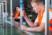 Concentrated workers on production line — Stock Photo