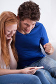 Young couple with a pregnancy test — Stock Photo