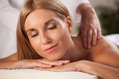 Neck massage in spa — Stock Photo