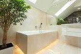 Illuminated bathtube in modern bathroom — Stock Photo