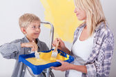 Mother and her son painting the wall — Stock Photo
