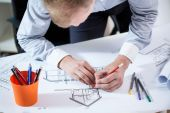 Architect designing the building. — Stock Photo