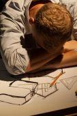 Architect sleeping at work — Stock Photo