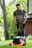 Man mowing the grass — Stock Photo