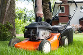Turning on the lawn mower — Stock Photo