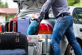 Too little car trunk for luggage — Stock Photo