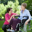 Nurse taking care of elderly woman — Stock Photo #53556677