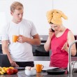 Busy couple in the morning in kitchen — Stock Photo #53613793