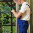 Repairman fixing a terrace door — Stock Photo #53615563