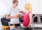 Couple during breakfast in the kitchen — Stock Photo