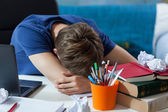 Student sleeping on his notes — Stock Photo