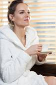 Lady drinking coffee in spa — Stock Photo