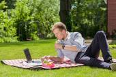 Businessman relaxing in a garden — Stockfoto