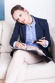 Businesswoman working on the phone — Stok fotoğraf