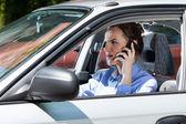Female driver calling on mobile phone — Foto de Stock