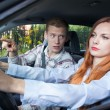 Screaming man and driving woman — Stock Photo #53949423