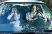 Mad couple in a car — Stock Photo