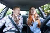 Frivolous woman making up in car — Stock Photo