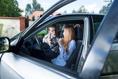 Serious quarrel in a car — Stock Photo