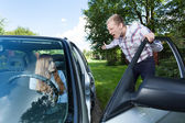 Mad man screaming at female driver — Stock Photo