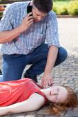 Man sending for an ambulance — Stock Photo