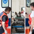 Woman lying on stretcher in ambulance — Stock Photo #53951073