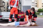 Paramedics applying first aid — Stock Photo