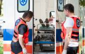 Woman lying on stretcher in ambulance — Stock Photo