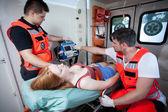Paramedics applying first aid in ambulance — Stock Photo