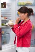 Girl eating cream cake — Foto de Stock