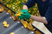 Cleaning the rain gutter during autumn — Foto Stock