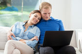 Happy marriage with laptop — Stock Photo